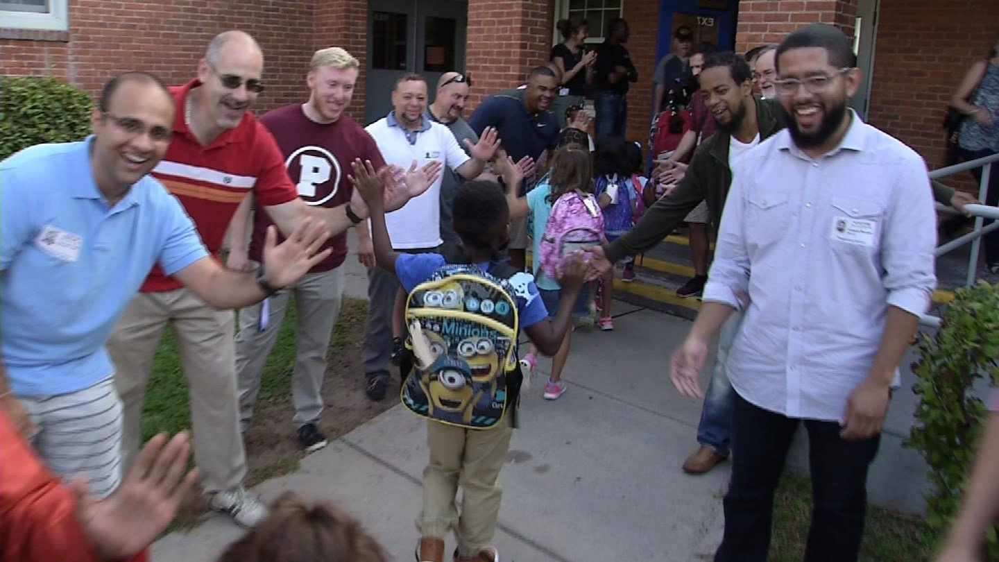 A group cheered on students at schools across Windsor on Friday. (WFSB)