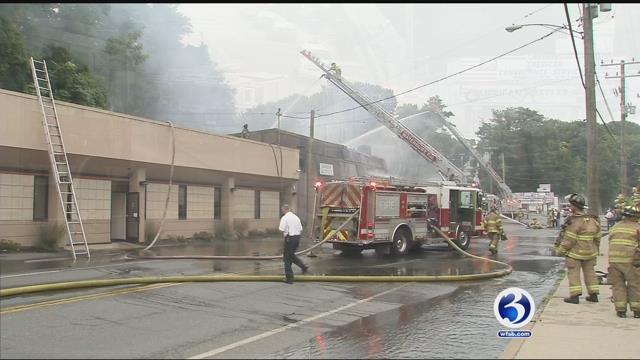 Furniture store fire burns in Waterbury