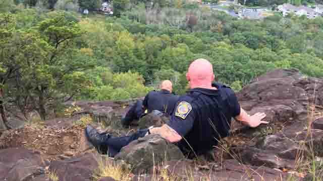 Police officers rescued a woman from a cliff at Sleeping Giant on Wednesday (Hamden Police)