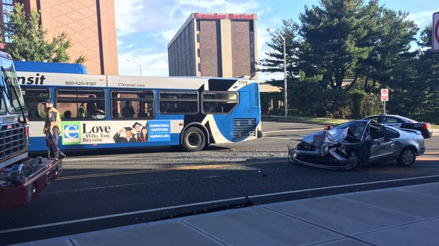 A CTtransit bus and a car was reported on Pleasant Street in Hartford on Friday. (WFSB)