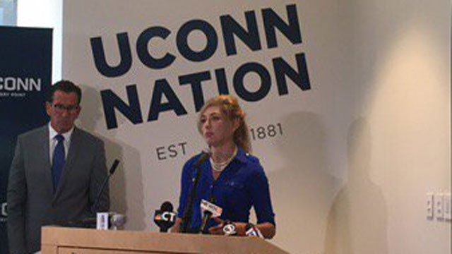 Gov. Dannel Malloy looks on as UConn president Susan Herbst says big short term cuts will hurt us for a long time. (WFSB)