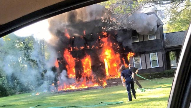 Crews battled a fire at a home in Stafford on Monday (WFSB)
