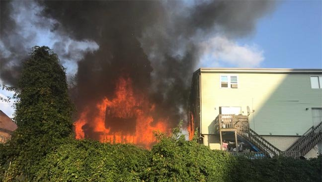 Crews battled a fire that spread to two homes in Stamford (Stamford fire officials)
