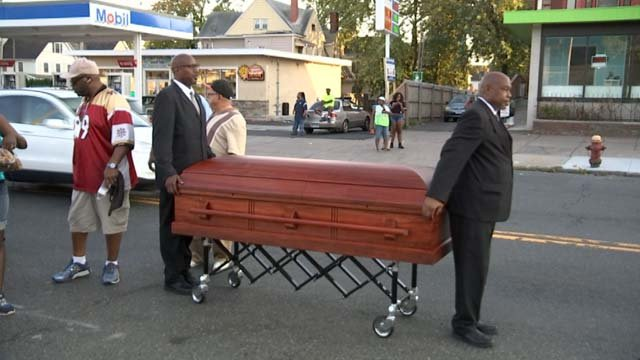 Activists marched through Hartford behind a coffin symbolizing those lost to violence (WFSB)