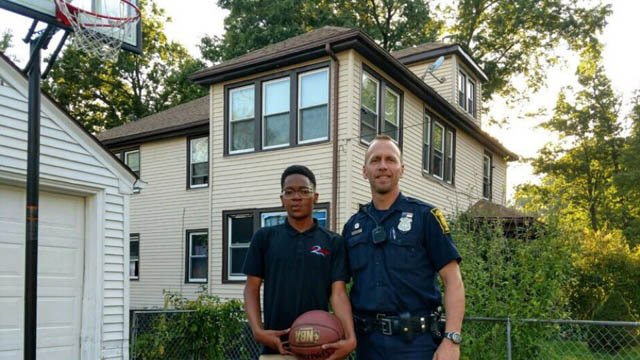 Hartford police officer Officer Finucane saw a boy's broken basketball hoop and decided to do something about it. (D/C Foley)