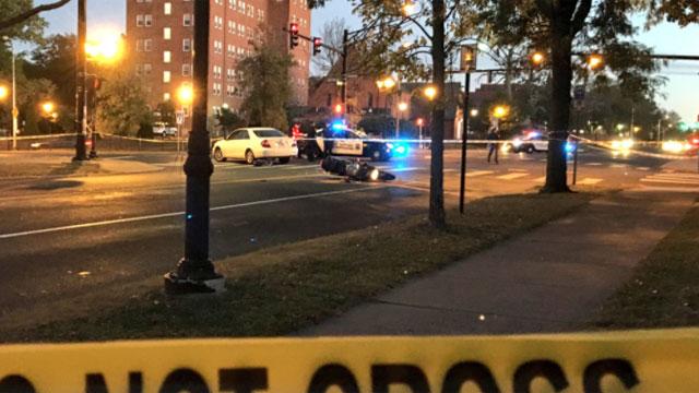 Washington Street in Hartford was closed following a crash involving a motorcycle and a car. (WFSB)