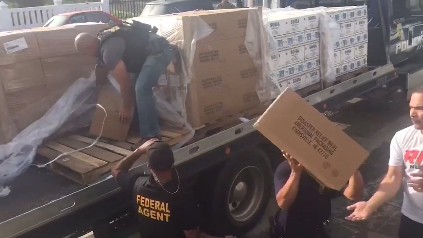 Federal agents unload supplies in hurricane-battered Puerto Rico. (CBS)