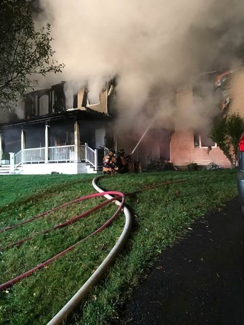 Firefighters knock down the blaze (Photo Courtesy of Oxford Fire Department)