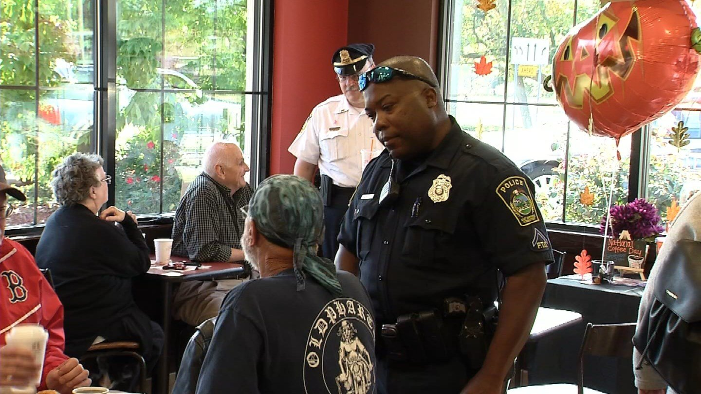 """The East Hartford Police Department held its """"Coffee with a Cop"""" event on Wednesday at a Dunkin' Donuts in town. (WFSB)"""