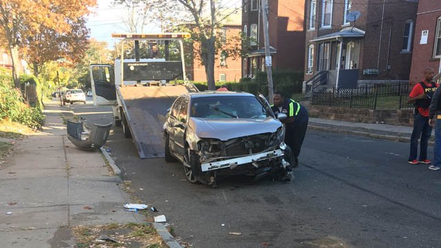 A suspect in a drug investigation plowed into four parked cars in the Babcock Street area of Hartford on Friday. (WFSB)
