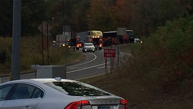 A crash involving a tractor-trailer and a tour bus on Interstate 84 in Middlebury happened on Friday evening. (WFSB)
