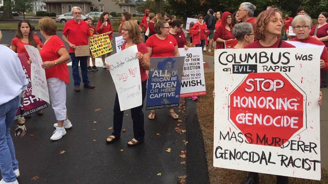 Dozens of people protested a new Christopher Columbus monument in Southington on Monday. (WFSB)