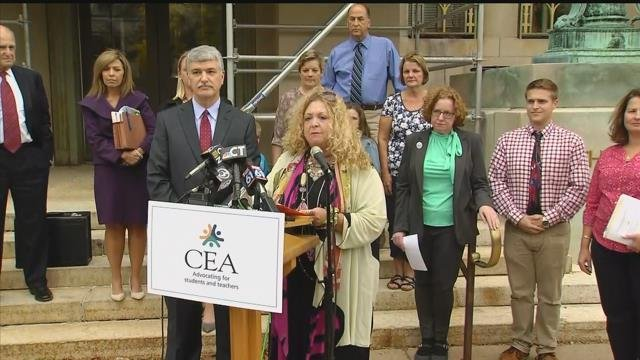Connecticut teachers union holds news conference on teachers and parent after filing injunction against state. (WFSB)