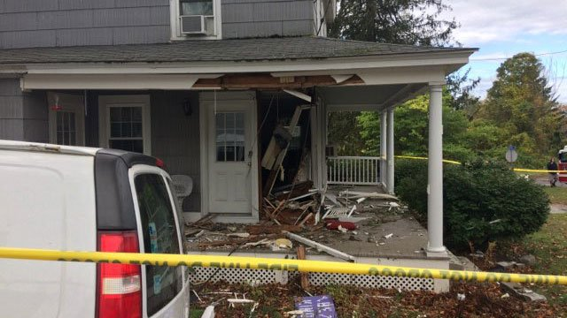 A car crashed into a home in Plymouth on Thursday afternoon. (WFSB)