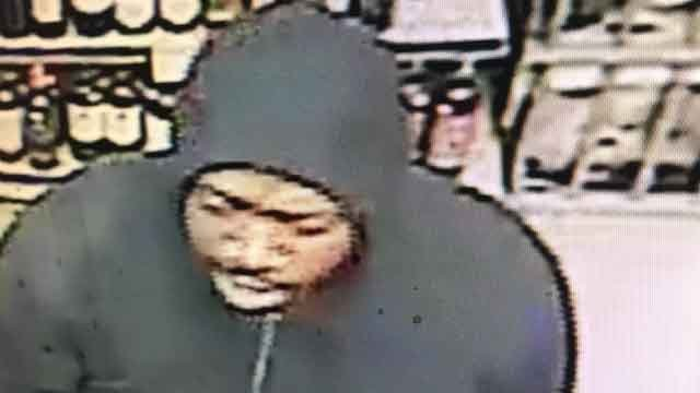 Police in Wolcott are asking for the public's help in identifying a man accused in a liquor store robbery. (Wolcott Police)