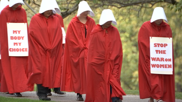 """Protesters dressed from """"Handmaid's Tale"""" take to the Capital"""