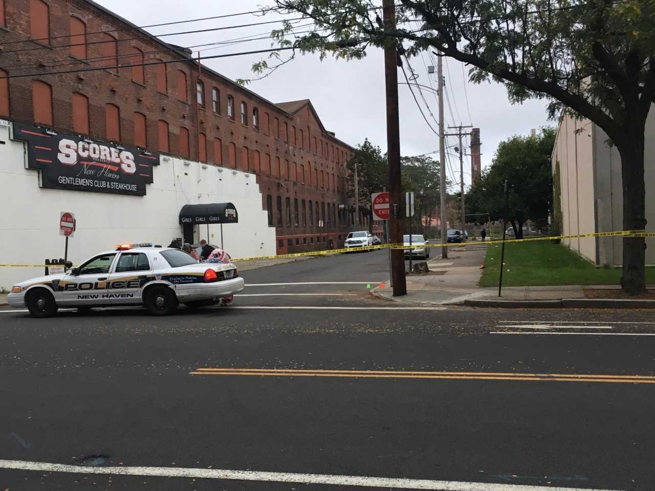 New Haven Police taped off an area of Hamilton Street near the Score's Gentleman's Club
