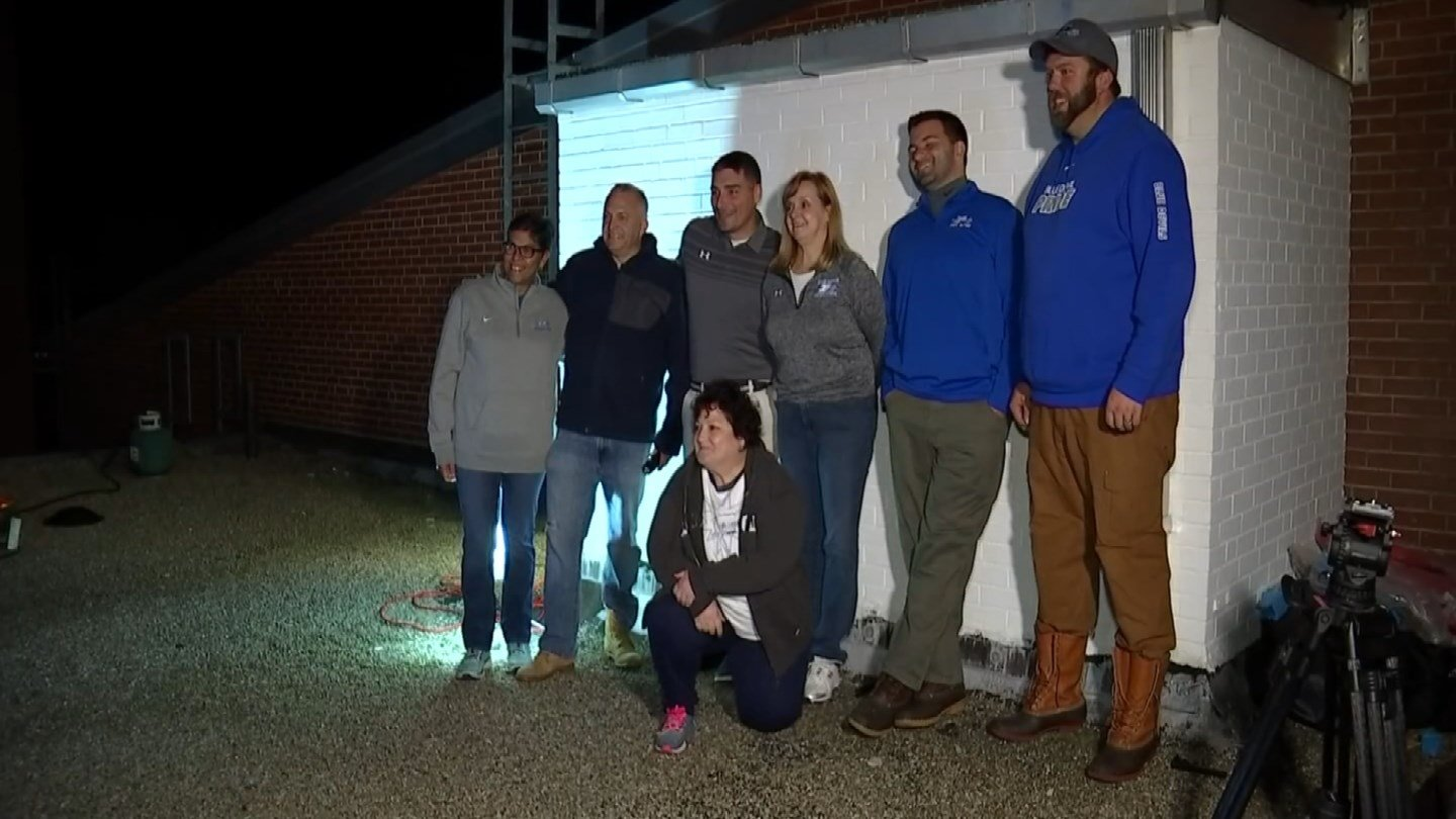 Plainville High School's administrators camped out on the school's roof to reward students for contributing to hurricane relief efforts. (WFSB)