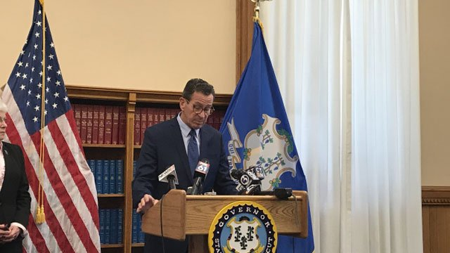 The governor speaks about the signing of state budget. (WFSB)