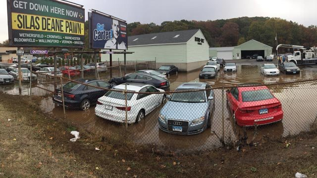 Dozens of Audi and Porsche cars were water-logged after a hydrant burst near a Wallingford dealership overnight. (WFSB)