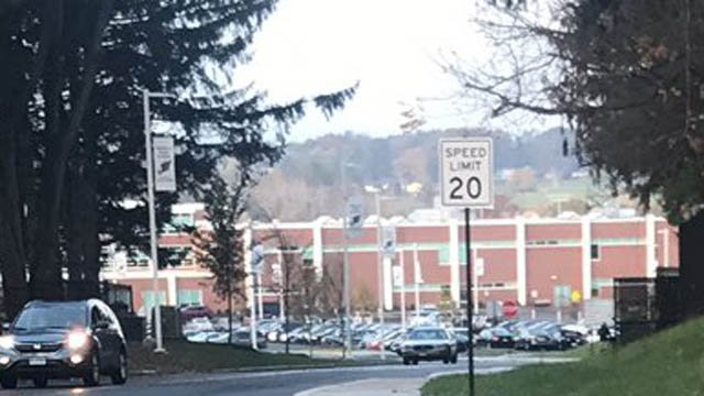 A suicidal girl threatened to shoot an ex-boyfriend at Enfield High School on Friday morning and it prompted a lockdown, according to police. (WFSB)