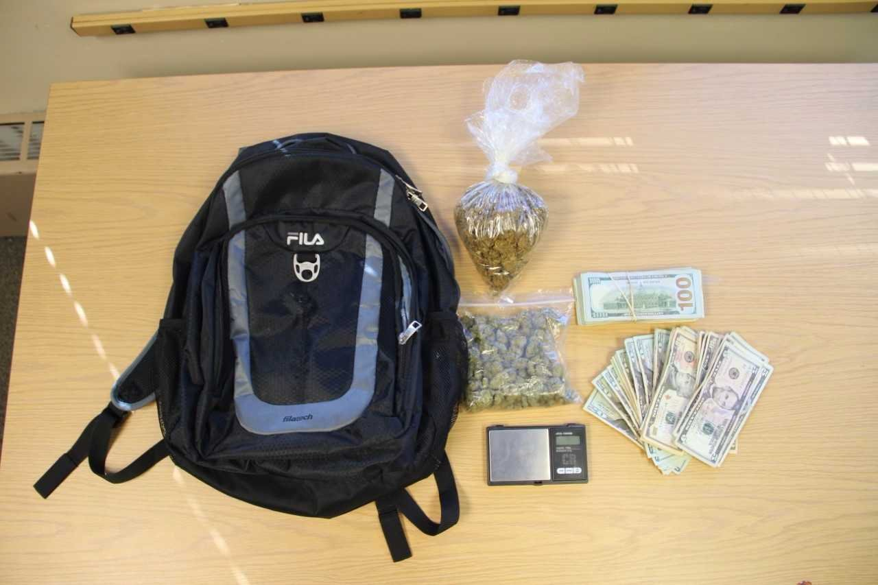 Police said they said more than four ounces of marijuana, a digital scale, and over $2,000. (Photo Courtesy of New London Police Department).