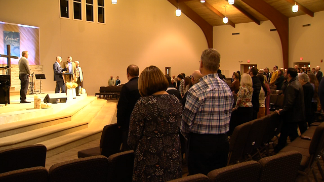 The Emmanuel Baptist Church in Newington held a moment of prayer for the victims in the Sunday's mass shooting in Texas.  (WFSB)