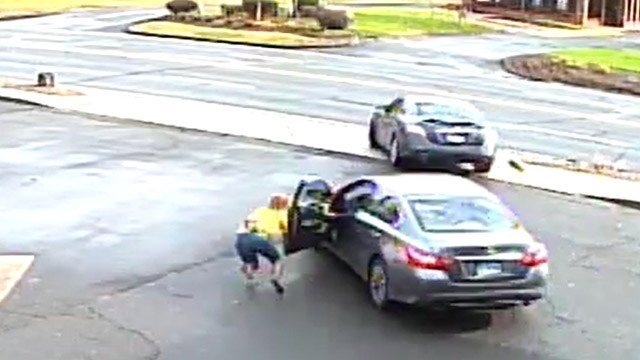 A woman was dragged after a carjacking in Windsor Locks on Monday morning. (Windsor Locks Police Department)