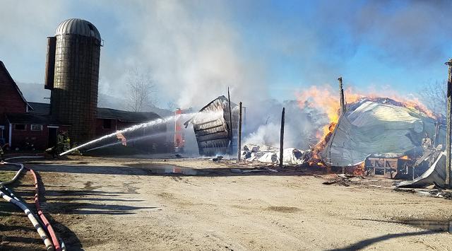 Multiple crews battle heavy fire at a barn in Salisbury (Norfolk Fire Department)