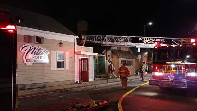 Crews battled a fire at Nita's Restaurant in Willimantic on Wednesday (Matthew Vertefeuille)