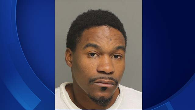 PD: Man fired gun at officer, dragged robbery victim by hair