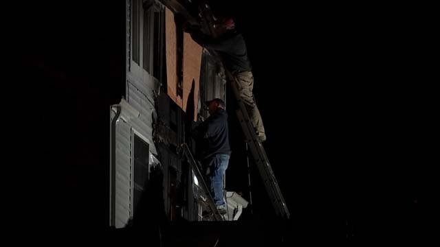 Crews worked to cover damage that was done to the home (WFSB)