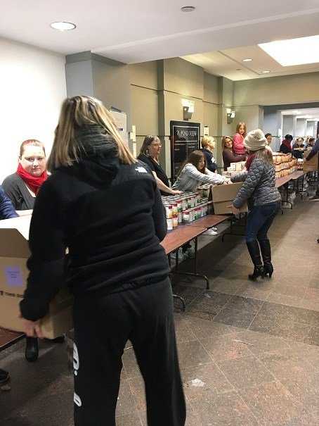 A line of all the fixing being put in boxes for families in need.  (WFSB)