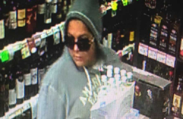 East Haven police are searching for a woman who they said stole a donation jar from a liquor store. (East Haven Police image)