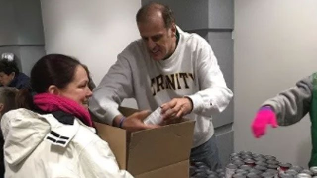 Employees of KBE Building Corporation along with help from their families spent their Saturday morning packing up Thanksgiving meals. (WFSB)