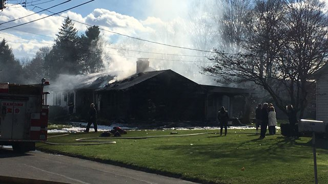 Firefighters battled a house fire in Hamden on Monday afternoon. (WFSB)