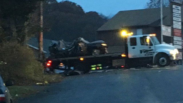 The car involved in the deadly crash in Waterbury on Wolcott St. is being towed from the house it hit. Police said the two people in the car were killed. No one inside the house was hurt. (WFSB)