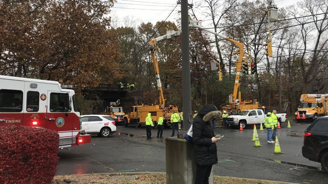 A vehicle i doing work on train tracks and knocked down some wires in North Haven on Wednesday.  (WFSB)
