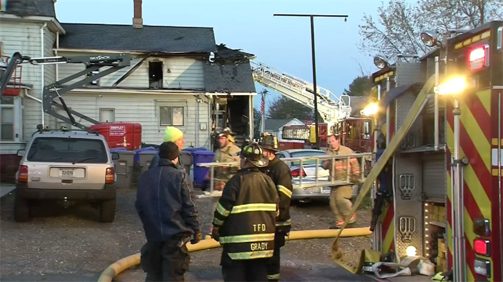 Dozens of firefighters were called to battle a house fire that claimed the life of a 21-year-old man. (WFSB)