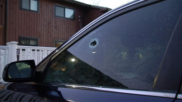 Officers located five cars at Squire Village Apartments that were damaged by gunshots. (WFSB)