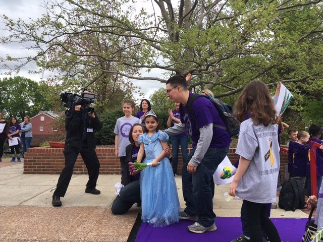 Maven Borgen, dressed as a Princess, is greeted by her family and friends at her school for her last day of radiation. (WFSB)