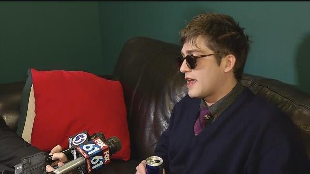 Lucian Wintrich speaks with the media after his arrest. (WFSB)