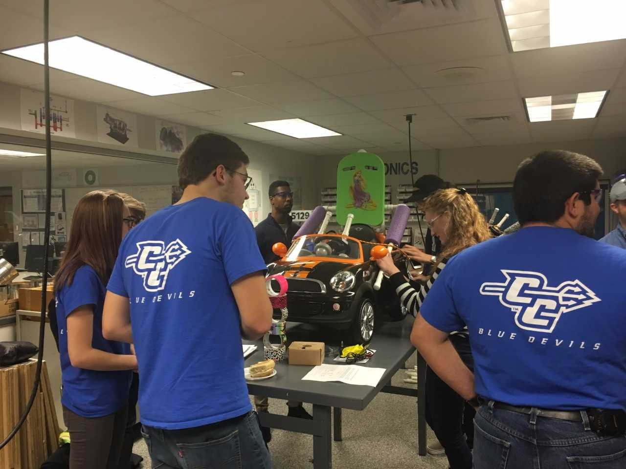 Plainville High School along with middle school students and students from Central Connecticut State University refurbished and adapted toy cars for nine toddlers with special needs on Saturday morning.(WFSB)