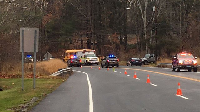 A crash involving a school bus with students aboard was reported in Simsbury on Wednesday morning. (WFSB)