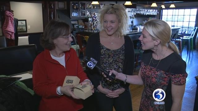 Christine Castonguay, who is undergoing treatment for ovarian cancer, gets surprised by the Liberty Bank Surprise Squad. (WFSB)