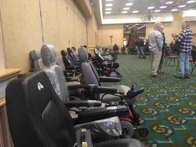 Phil Pavone, owner of AZ Pawn. collects, refurbishes, and gives away wheelchairs like these at the annual Gift of Mobility event in Norwich. (WFSB)
