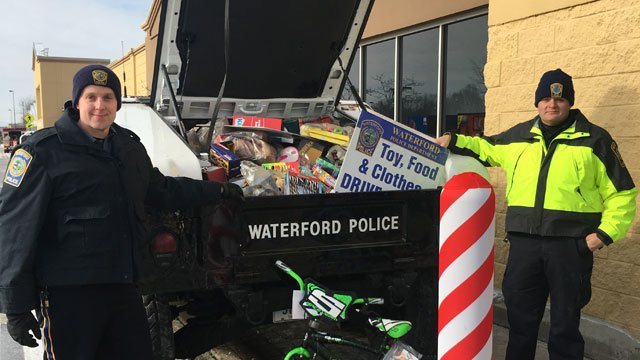 Police collected toys in Waterford on Saturday. (WFSB)