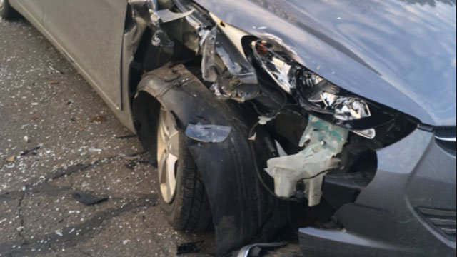 A parked car in Tolland got swiped by a school bus according to eyewitnesses. (WFSB)