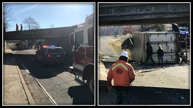 A box truck tipped onto its side on Wednesday morning (WFSB)