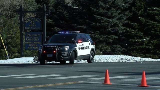 Police closed Town Farm Road after a body was found at the golf course (WFSB)